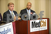 5.28.14- BALTIMORE, MD- From Left, Vincent DeMarco, President of the Maryland Citizens Health Initiative, and Maryland State Delegate Shawn Tarrant,  seen talking at the press conference at MedChi where health care advocates announced majority support in the Maryland General Assembly for life saving tobacco tax for hearth care proposal.  (The Daily Record/Maximilian Franz)