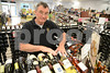 5.29.14- GAITHERSBURG, MD- Jim Fassanella, Manager of store number 20, owned by the Montgomery County Department of Liqour Control, shown here organizing their French wine selection, in the Potomac Valley Shopping Center.  (The Daily Record/Maximilian Franz)