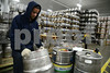 5.29.14- GAITHERSBURG, MD- Photo of Jesse Mejia, Warehouse Worker at the Montgomery County Department of Liqour Control, shown here filling an order in the Keg Box.  (The Daily Record/Maximilian Franz)