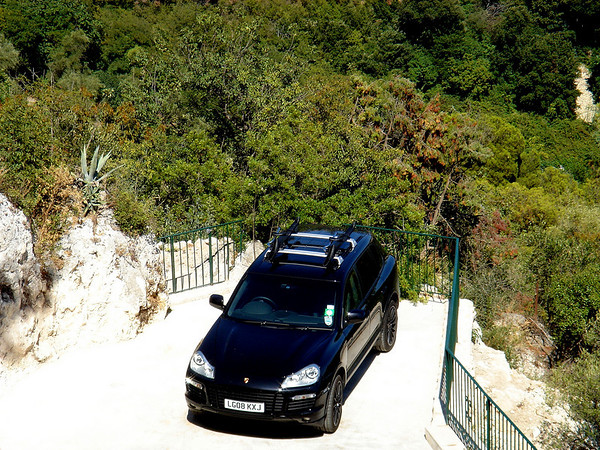 One of the exquisite vehicles parked at the Château de la Chèvre d'Or Eze Village, Alpes-Maritime, France.  <br /> <br /> This romantic, thoroughly unique 4-star luxury hotel just may be located in the most breathtaking spot on the French Riviera, high above the Mediterranean. From most of the rooms, the terraces and the restaurants (all on different hillside levels), the constantly changing palate of colors of sky and sea will create a memory that will last a lifetime.