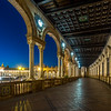 Night under the Arcades of the Plaza de España, Seville, Spain