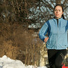 """Hamilton: Emily Lanois, a senior cross country star at Hamilton-Wenham High School, who was heavily recruited by Ivy League Schools, has chosen to attend Columbia University in New York City. Here Emily runs through the neighborhood near her home in Hamilton. Despite the frigid temperatures Emily was determined to excersize. """"I get antsy if I don't run,"""" said Lanois. Photo by Deborah Parker/Salem News Friday, January 16, 2009."""