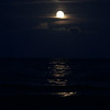 beach moonrise reflections