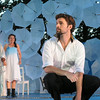 Prospero (Craig Wallace) and his daughter Miranda (Leah Filley) look on as Ferdinand (Alexander Korman) laments his father's fate in Olney Theatre Center's production of THE TEMPEST. (Photo: Stan Barouh)