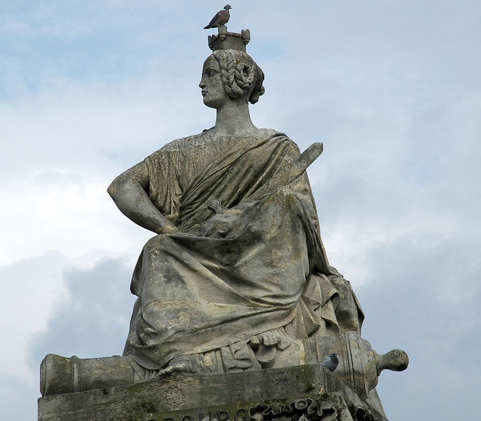 Statue with contradicting war and peace symbols in Paris, France