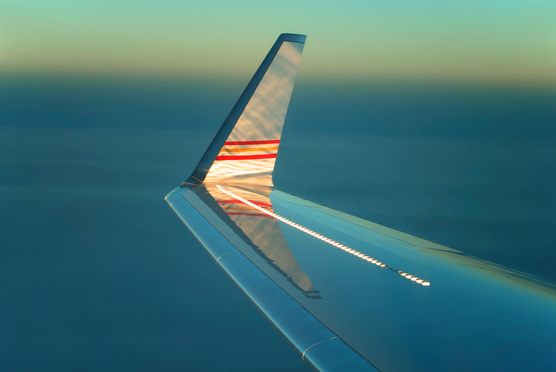 Reflections on airplane wing(let) just before sunset