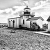 02 Jun 15.  This is another of the images for the book, except that the book version will more than likely be in color. But that could change with the cost of color reproductions being significantly greater than that for B&W. This is the Point-No-Point light house in Hansville, WA, the oldest of all the light houses on Puget Sound. It has an identical sister on the Seattle side located in what is now known as Discovery Park but was originally an Army base, Fort Lawton. The one in Discovery Park was built from the plans used to build the Point-No-Point - an interesting name and one I'll discuss later - original and was done to save money.  This light house still blinks but no longer uses the oil lamps that were employed when initially constructed and now sits in what has been converted to a county park. I've added a little texture to counter the effects of the buildings being photographed in heavy shade, a welcome situation as it means we were having a very nice sunny day, but otherwise, other than being in B&W, it is virtually as I took it.<br /> <br /> The base image was adjusted for max tonality, then a bit of texture added to the buildings, the colors adjusted for best display, and then converted to B&W. Nikon D300s; 18 - 200; Aperture Priority;  ISO 200; 1/2000 sec @ f / 5 (I was tired and lacking a tripod for stability).