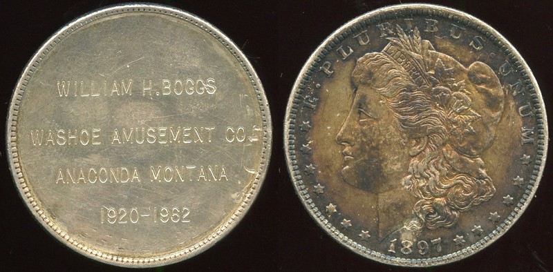 MISCELLANEOUS -- Engraved Coin<br /> <br /> Lot XXX:  WILLIAM H. BOGGS / WASHOE AMUSEMENT CO. / ANACONDA MONTANA / 1920 – 1962 on obverse of 1897 Morgan dollar.    G4-($64-$125)
