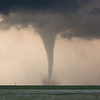 A slender tornado kicks up dust and debris near Last Chance, CO, on June 10, 2010.