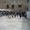 Jerusalem--women's section of the wailing wall. They are watching bar mitzvahs over the dividing wall on the left of the photo
