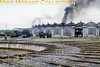 A panoramic view of the dépôt Lyon, Vénissieux roundhouse and associated smoke taken on 7/9/62.
