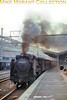 Japan Railways JNR light Pacific No. D51.1054 leaving Kyoto station with the last Hiroshima stopping train of the day on an unspecified date in 1966. <br> [Photographer: R. E. Field/<i>Mike Morant collection</i>]