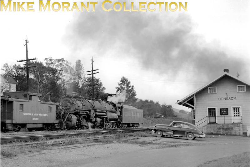 Norfolk and Western Y6 class 2-8-8-2 shoving hard on an eastbound coal train going up Blue Ridge at Bonsack VA in August 1958. The cabside number is barely visible but seems to be 212?.<br> [Photographer: R. E. Field/<i>Mike Morant collection</i>]