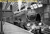 """Pictures taken beneath the imposing roof at Cannon Street station in London are quite rare and it's been a pleasure to work with this very good quality negative featuring Maunsell Schools class 4-4-0 no. 911 <i>Dover</i> prior to departure for its namesake. The only note accompanying this negative states , enigmatically, """"Cannon Street 1/15 Sats"""".<br> Sadly, my only other shot of this loco is a colour slide taken in the yard at Hove in April 1963 long after it was withdrawn.<br> [<i>Mke Morant collection</i>]"""