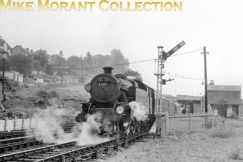 One of the Southern's contingent of Fairburn 4MT 2-6-4T's, no. 42102, photographed on 6/9/58 at the rarely photographed Upper Warlingham station on the Croydon to Oxted line. 42102 had been built at Brighton and entered dervice in September 1950 remaining a Southern engine until transfer to Watford mpd in November 1959. Withdrawal came at Springs Branch in December 1966.<br> [<i>Mke Morant collection</i>]