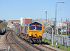 66732 on a loaded spoil train from Westbourne Park to Northfleet climbing to the Thames crossing at Imperial Wharf.