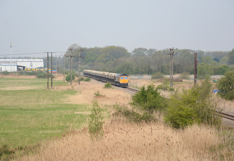 After running round in King's Lynn the 6L88 heads along the branch to Middleton Towers which threads its way through Lynn's Hardwick Industrial Estate (on the left). Just above the tree line to the right is the top of the Bentinck Dock grain silo