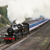S& DJR  7F No. 53809 bearing a Pines Express headboard departs Andover with a special for Ludgershall