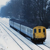 Class 205 DEMU 205019 runs through a snowy landscape around Hurst Green on its way back into London