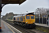 66722 runs light engine through Addlestone working from  Hoo Junction Up Yard to Eastleigh East Yard<br /> <br /> 16 February 2015