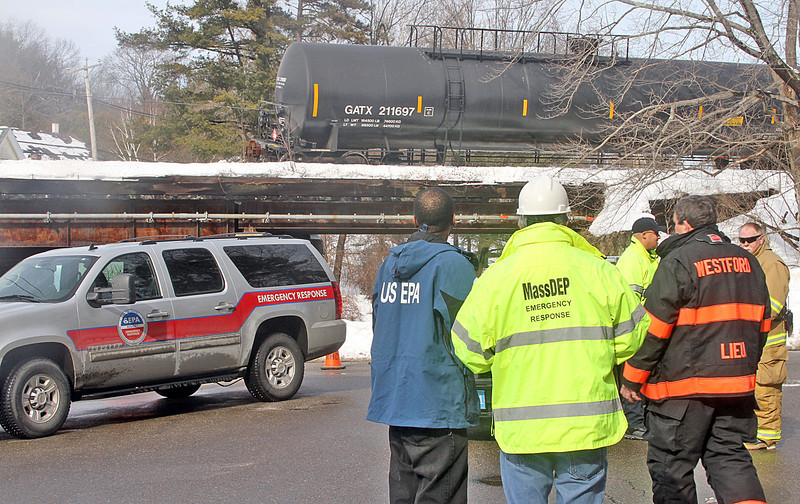 Westford fire and police stand by as workers from PanAm, (railroad), work on placing three tank cars and two box cars back on track in the Graniteville section of Westford  .  SUN/ David H. Brow
