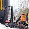 Westford fire and police stand by as workers from PanAm, (railroad) shown here, work on placing three tank cars and two box cars back on track in the Graniteville section of Westford  .  SUN/ David H. Brow
