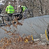Westford fire and police stand by as workers from PanAm, (railroad)(here they inspect one of the tank cars), work on placing three tank cars and two box cars back on track in the Graniteville section of Westford  .  SUN/ David H. Brow