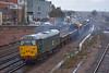 DCR green liveried 31452 leads 6Y75 away from Eastleigh back to its base at Totton in pouring rain.  27 February 2014