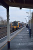 Desiro 450115 races non-stop  through Hersham with 2L25  the 10.12 from  Waterloo to Basingstoke<br /> <br /> 16 January 2013
