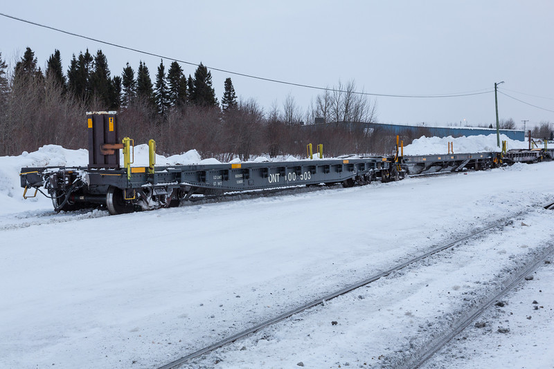 Flatcars or chain cars ready for tomorrow's Polar Bear Express in Moosonee. 100503, 100502, 100501, 100500.