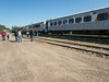 Passengers get off Polar Bear Express at Otter Rapids while train waits for an ambulance.