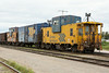 Ballast train at Cochrane. Caboose 1873, boxcar 2597, caboose 124 at end of train.