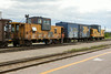 Ballast train at Cochrane. Caboose 1873, boxcar 2597, caboose 124.