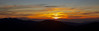 Sun setting over the distant hills of the South Island, taken from Mt Holdsworth summit Feb 2013