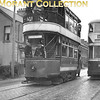 <b>Belfast trams</b><br> This shot has tram spotters/track bashers written all over it but I don't know what the occasion was and therefore not the date either. We see here Red Tram 238 and McCreary car 410 which is on route 5 bound for Castle Junction.<br> <i>[Mike Morant collection]</i>
