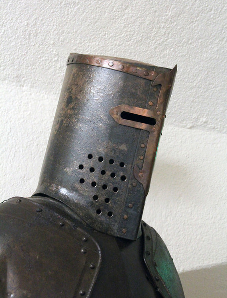 "<span style=""color:yellow;"">Sure seems it would be hard to see your enemy through those narrow slots.  Can you imagine the sound inside the helmet when a sword strikes it?   </span>"