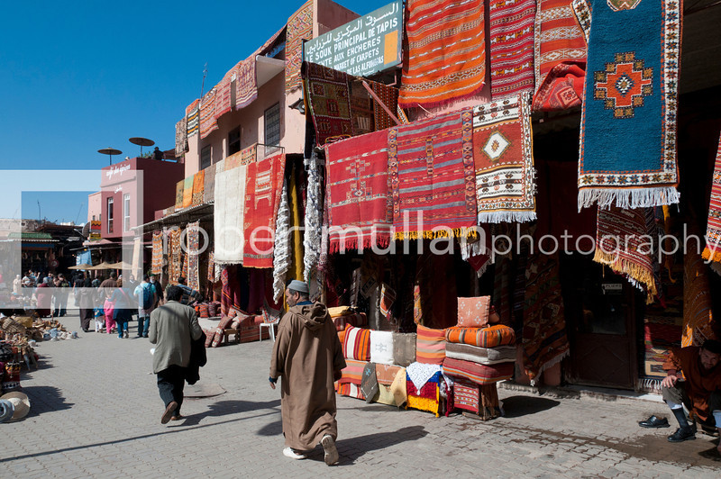 Marrakech, Morocco - Street scene in the busy souk market at Rahba Qedima in Medina district, Marrakech, North Africa