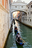 Romantic gondola cruise through the canals of Venice in evening light