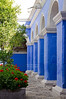 Blue colonnade in the Orange Tree Cloister of the Santa Catalina Monastery in Arequipa, Peru