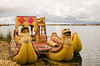 Reed boat docked to the floating islands of the Uros People, Lake Titicaca, Peru