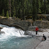 Tourists at Natural Bridge in Yoho National Park in Alberta, Canada