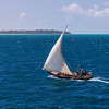 Tanzania A Dhow sails along on the Indian Ocean between Zanzibar and Dar es Salaam.