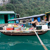 HaLong bay is home to many floating villages where the villagers live in houses floating in protected inlets. This boat serves as a floating market, with supplies that the villagers need