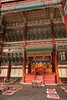 Geunjeongjeon Hall holds the royal throne room of the Gyeongbokgung Palace complexin Seoul Korea. The ornate decorations of the hall are painted in bright red and green colors.
