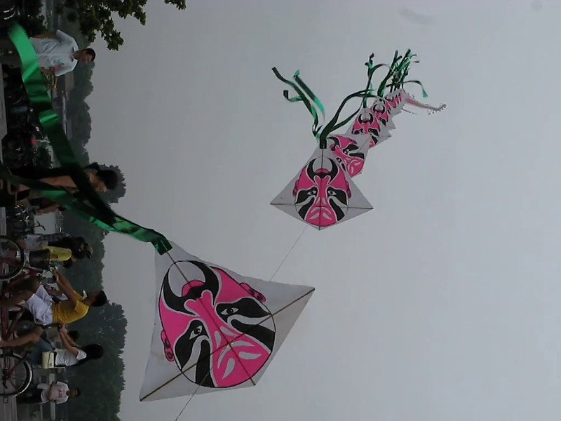 A string of Beijing opera face kites.
