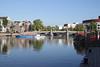 River Amstel and Blauwbrug Bridge Amsterdam Holland