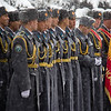 Soldiers waiting for the start of ceremonies on 'Defenders of the Fatherland Day' in Bishkek.