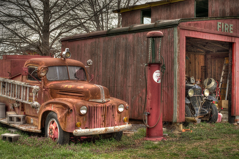 Old fire truck in the faux town of Red Oak Two, near Carthage Missouri.