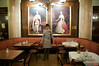 Rosa poses in front of paintings of Emperor Francis Joseph I and Empress Elisabeth of Bavaria (Sisi) at Cafe Central. IMG_6907