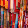 Selection of wonderfully bright colourful cloth at a market stall in Marrakesh